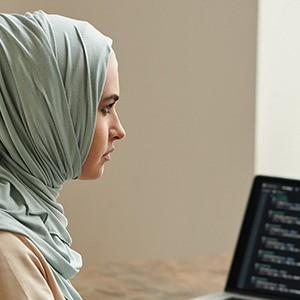 A woman expanding the functionality of her websites by programming the software