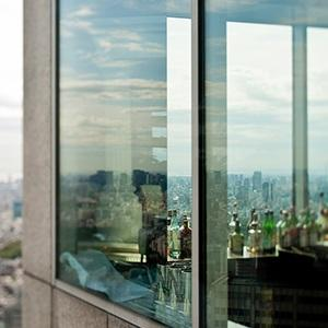 View of a large city through glass windows