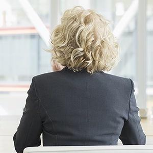 Back of a woman in a business suit