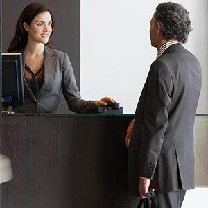 A businessman checking into a hotel