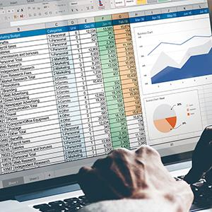 A computer screen showing multiple pages of business information and graphs